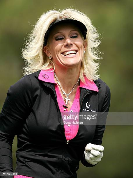 Danielle Amiee winner of the Golf Channel's Big Break III laughs as she walks off the ninth tee during the first round of the Michelob Ultra Open at...
