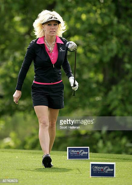Danielle Amiee winner of the Golf Channel's Big Break III walks off the tenth green during the first round of the Michelob Ultra Open at the...