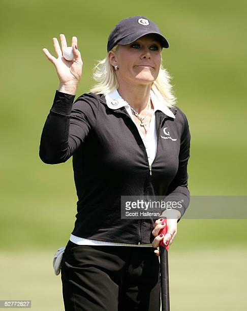 Danielle Amiee winner of the Golf Channel's Big Break III waves to the gallery on the ninth green after finishing the second round of the Michelob...