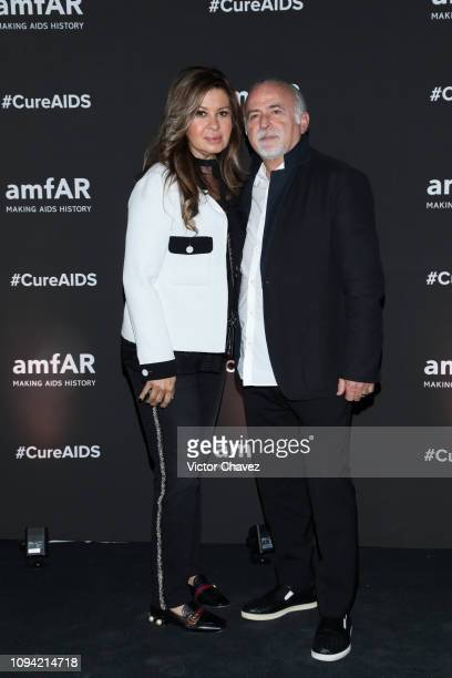 Danielle and Manik pose during the amfAR gala dinner at the house of collector and museum patron Eugenio López on February 5 2019 in Mexico City...