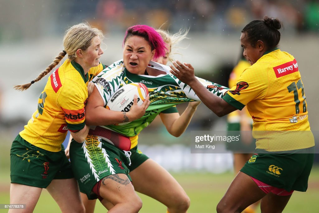 Danielle Apaiana of Cook Islands is tackled during the 2017 Women's Rugby League World Cup match between Australia and Cook Islands at Southern Cross Group Stadium on November 16, 2017 in Sydney, Australia.