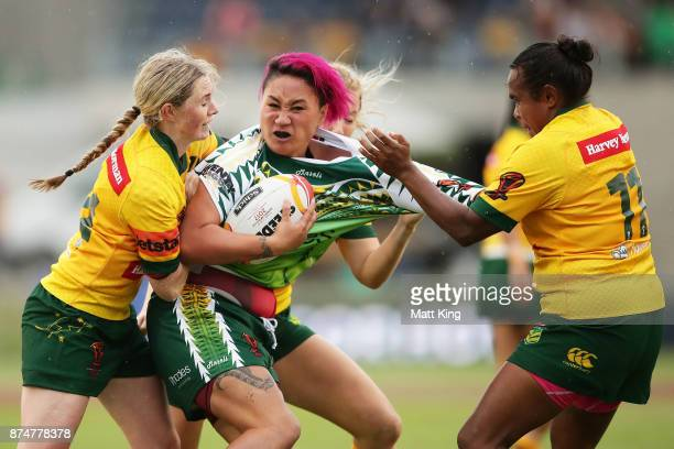 Danielle Apaiana of Cook Islands is tackled during the 2017 Women's Rugby League World Cup match between Australia and Cook Islands at Southern Cross...
