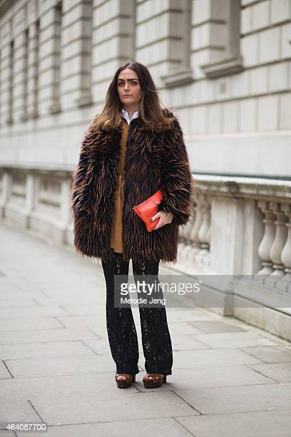 Danielle Bailey wears an HM outfit a Comme des Garcons pouch and Kurt Geiger shoes during London Fashion Week Fall/Winter 2015/16 at the Julien...