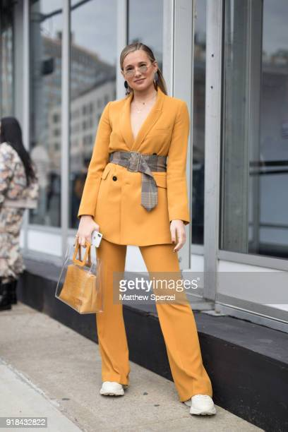 Danielle Bernstein is seen on the street attending Leanne Marshall during New York Fashion Week wearing a gold suit on February 14 2018 in New York...
