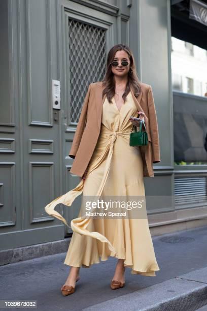 Danielle Bernstein is seen on the street during Paris Fashion Week SS19 wearing light brown blazer with yellow dress on September 24 2018 in Paris...