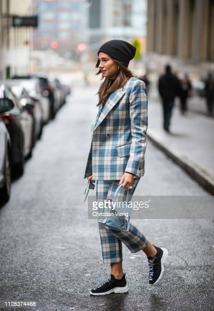 Danielle Bernstein is seen wearing plaid suit beanie outside Kate Spade during New York Fashion Week Autumn Winter 2019 on February 08 2019 in New...