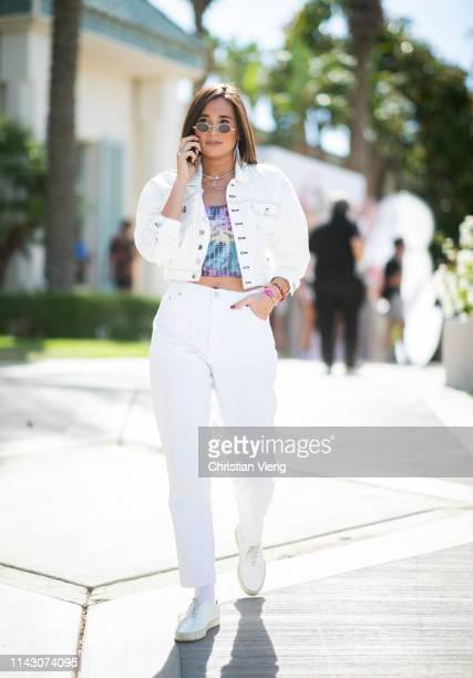Danielle Bernstein is seen wearing white denim jacket and jeans at the Revolve Festival during Coachella Festival on April 14 2019 in La Quinta...