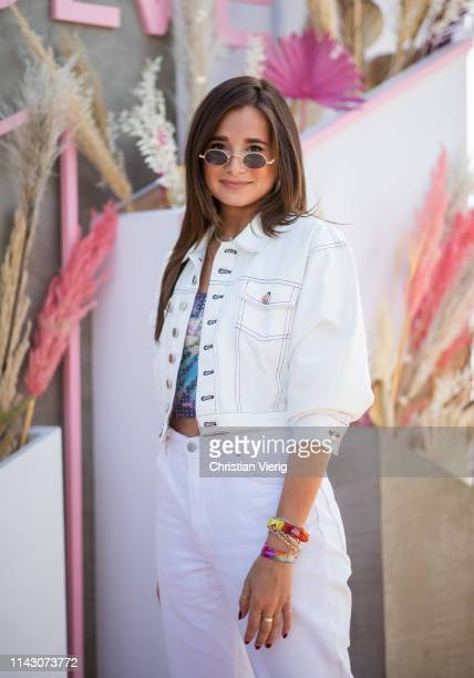 Danielle Bernstein is seen wearing white denim jacket and pants at Revolve Festival during Coachella Festival on April 14 2019 in La Quinta California