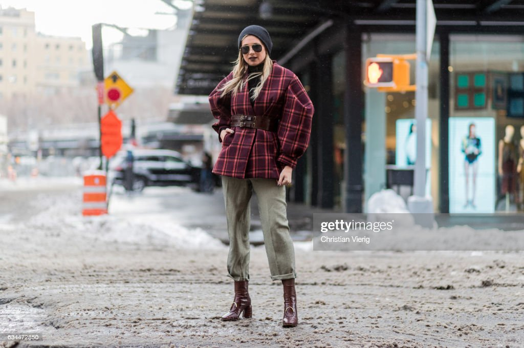 Danielle Bernstein wearing cropped olive pants, boots, checked red jacket, sunglasses, beanie outside Creatures of Comfort on February 9, 2017 in New York City.