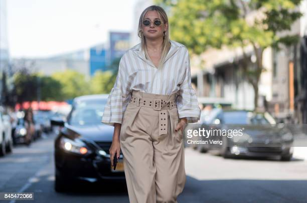 Danielle Bernstein wearing high waisted beige pants striped top seen in the streets of Manhattan outside Tome during New York Fashion Week on...
