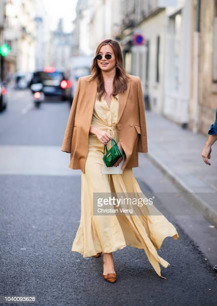 Danielle Bernstein wearing yellow dress brown beige blazer is seen outside Jacquemus during Paris Fashion Week Womenswear Spring/Summer 2019 on...