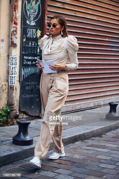 Danielle Bernstein wears a beige outfit to the Olivier Theyskens show during Paris Fashion Week Spring/Summer 2019 on September 28 2018 in Paris...