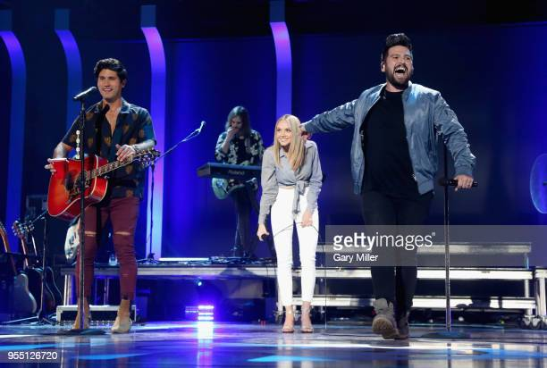 Danielle Bradbery and Dan Smyers and Shay Mooney of musical group Dan Shay perform onstage during the 2018 iHeartCountry Festival By ATT at The Frank...