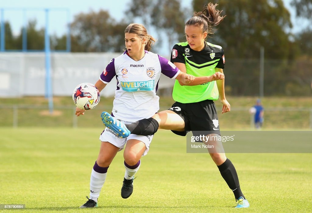 Danielle Brogan of Perth and Amy Sayer of Canberra contest possession during the round five W-League match between Canberra United and Perth Glory at McKellar Park on November 25, 2017 in Canberra, Australia.