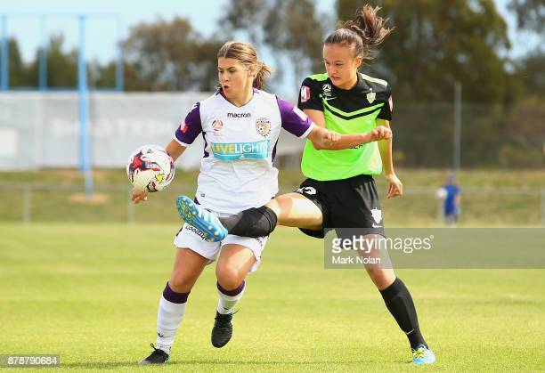 Danielle Brogan of Perth and Amy Sayer of Canberra contest possession during the round five WLeague match between Canberra United and Perth Glory at...