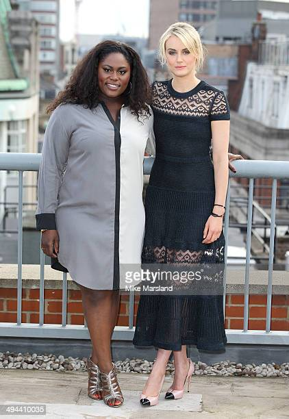 """Danielle Brooks and Taylor Schilling attend a photocall to launch season 2 of Netflix exclusive series """"Orange Is The New Black"""" on May 29, 2014 in..."""