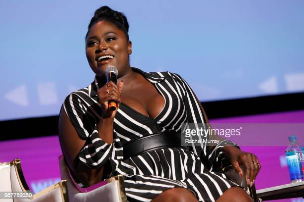 Danielle Brooks speaks onstage at the Rebels and Rule Breakers Panel at Netflix FYSEE at Raleigh Studios on May 12 2018 in Los Angeles California