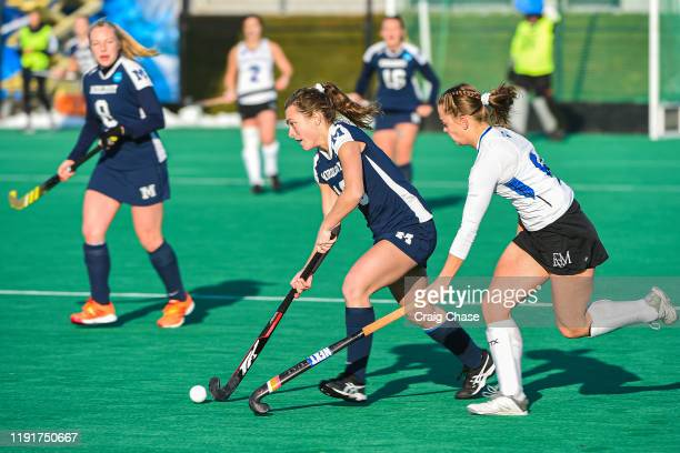Danielle Brown of Middlebury dribbles past Ellie Paige of Franklin Marshall during the Division III Women's Field Hockey Championship held at Spooky...