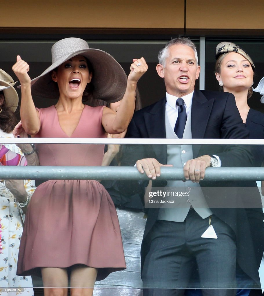 Danielle Bux and Gary Lineker watch horses cross the finish line on the opening day of Royal Ascot at Ascot Racecourse on June 14, 2011 in Ascot, United Kingdom.