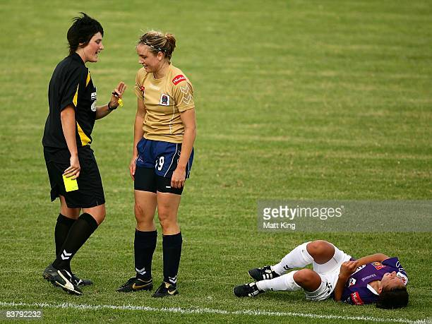 Danielle Calautti of the Glory lays down as Sanna Frostevall of the Jets is given a yellow card by referee Kate Jacewicz during the round five...