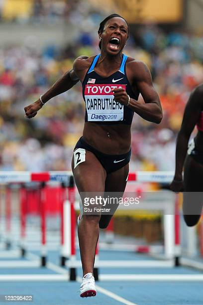 Danielle Carruthers of the USA crosses the finish line during the women's 100 metres hurdles heats during day seven of 13th IAAF World Athletics...