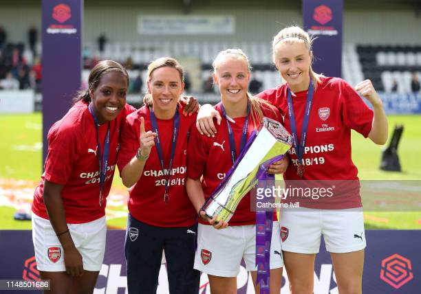 Danielle Carter Jordan Nobbs Beth Mead and Leah Williamson of Arsenal celebrate with the trophy after the WSL match between Arsenal Women and...