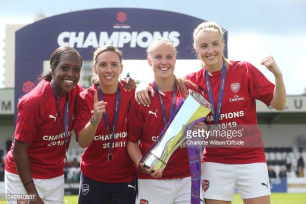 Danielle Carter Jordan Nobbs Beth Mead and Leah Williamson pose with the trophy during the Women's Super League match between Arsenal Women and...