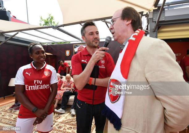Danielle Carter of Arsenal Ladies and Former Arsenal player Charlie George on stage as they help introduce the new Arsenal Puma Home kit at King's...