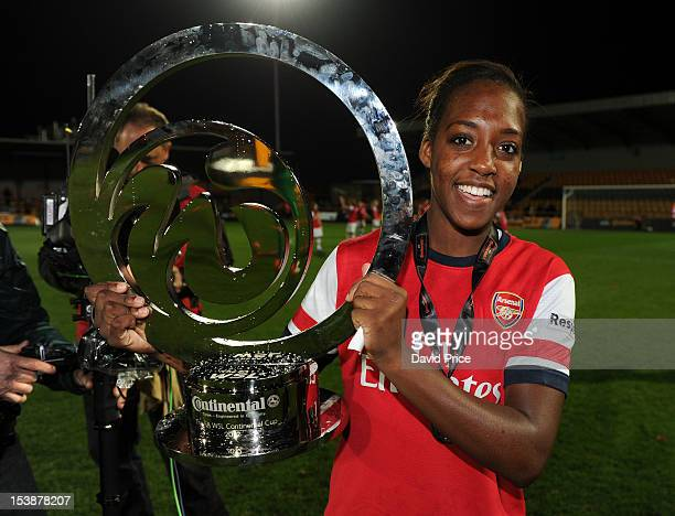 Danielle Carter of Arsenal Ladies FC with the WSL Continental Cup Trophy after the The FA WSL Continental Cup Final match between Arsenal Ladies FC...