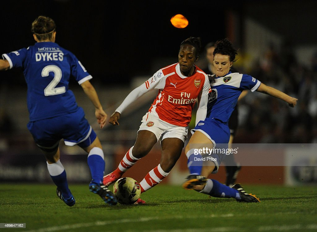 Danielle Carter of Arsenal Ladies is challenged by Loren Dykes and Jasmine Matthews of Bristol during the WSL match between Arsenal Ladies and Bristol Academy at Meadow Park on April 15, 2015 in Borehamwood, England.