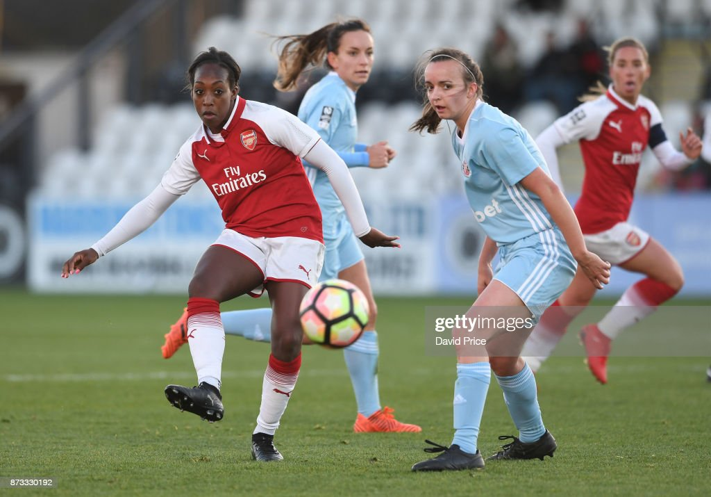 Danielle Carter of Arsenal passes the ball under pressure from Kaskia Lipka of Sunderland during the WSL match between Arsenal Women and Sunderland on November 12, 2017 in Borehamwood, United Kingdom.
