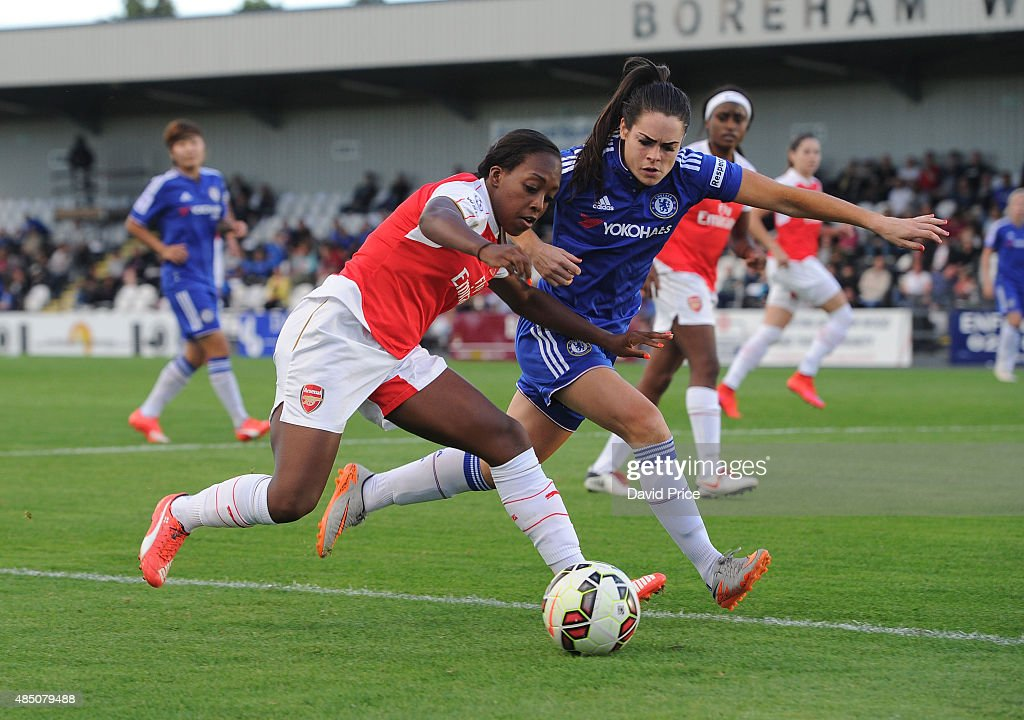 Danielle Carter of Arsenal takes on Claire Rafferty of Chelsea during the match between Arsenal Ladies and Chelsea Ladies at Meadow Park on August 23, 2015 in Borehamwood, England.