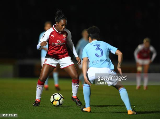 Danielle Carter of Arsenal takes on Demi Stokes of Man City during the match between Arsenal Women and Manchester City Ladies at Adams Park on March...