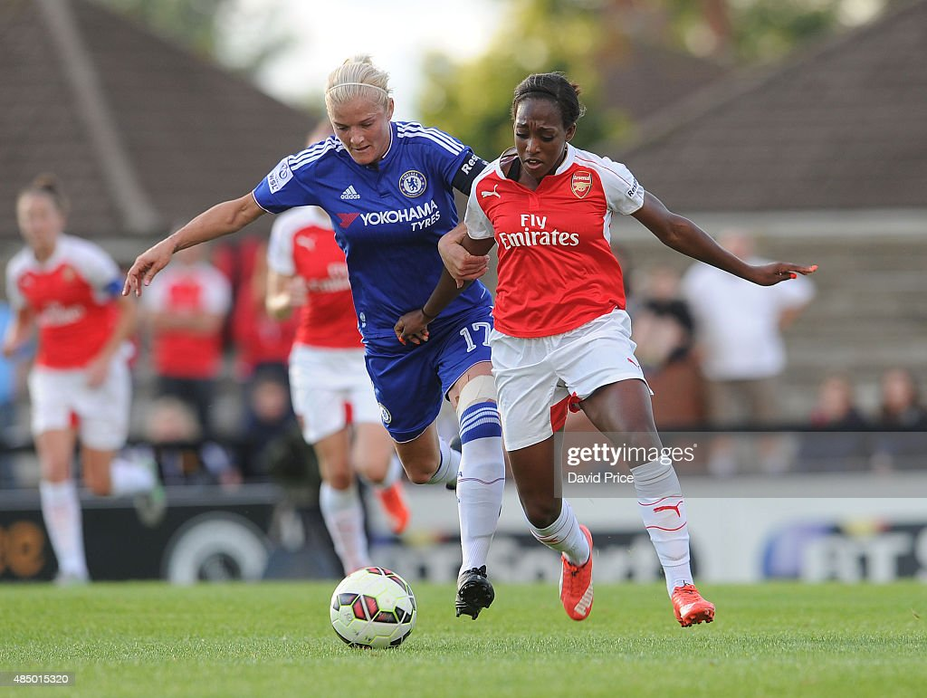 Danielle Carter of Arsenal takes on Katie Chapman of Chelsea during the match between Arsenal Ladies and Chelsea Ladies at Meadow Park on August 23, 2015 in Borehamwood, England.