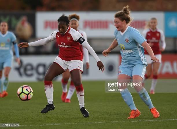 Danielle Carter of Arsenal under pressure from Ellie Stewart of Sunderland during the WSL match between Arsenal Women and Sunderland on November 12,...