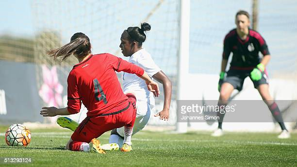 Danielle Carter of England and Joelle Wedemeyer of Germany fight for the ball during the women's U23 international friendly match between England and...