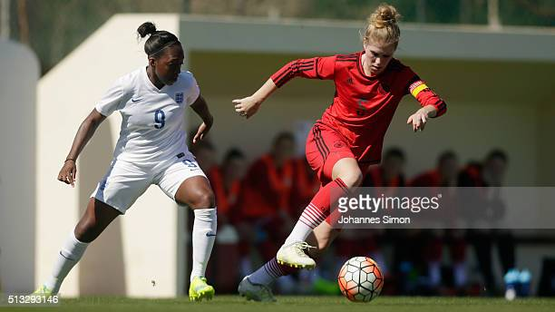 Danielle Carter of England and Rebecca Knaak of Germany fight for the ball during the women's U23 international friendly match between England and...