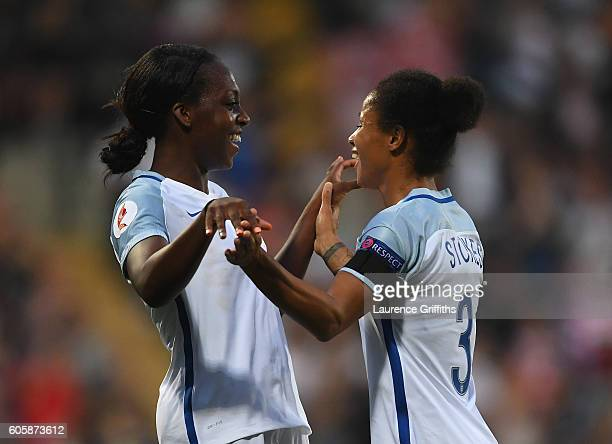 Danielle Carter of England is congratulated on scoring her second goal by Demi Stokes during the UEFA Women's Euro 2017 Qualifier between England and...