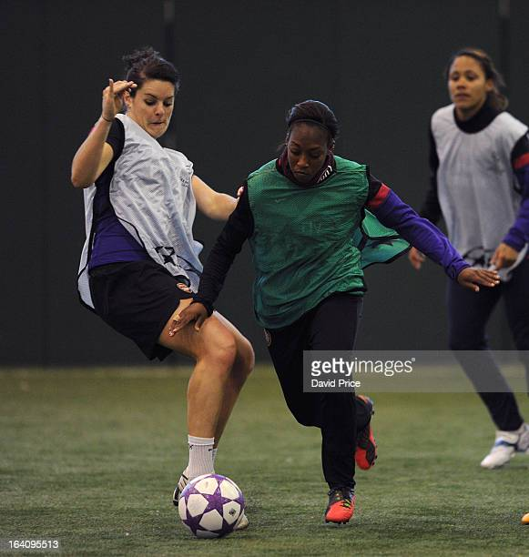 Danielle Carter skips past Jennifer Beattie of Arsenal Ladies during an Arsenal Ladies Training Session at Arsenal Training Ground on March 19 2013...