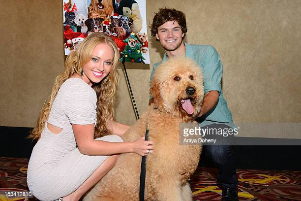Danielle Chuchran and James Gaisford arrive for the sneak preview of '12 Dogs Of Christmas Great Puppy Rescue' at AMC Century City 15 theater on...