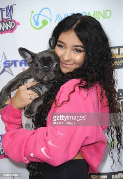 Danielle Cohn poses with her dog Blue at the Music Video Release Party For Lights Camera Action held at Starwest Studios on January 19 2019 in...