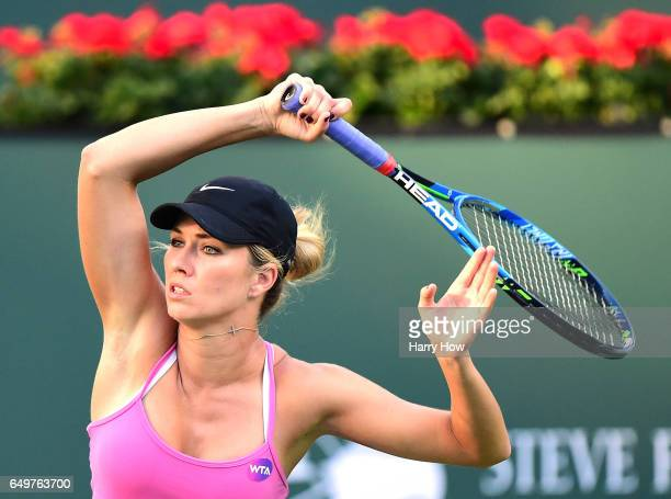 Danielle Collins follows through on her forehand in her match against Monica Puig of Puerto Rico during the BNP Parisbas Open at Indian Wells Tennis...