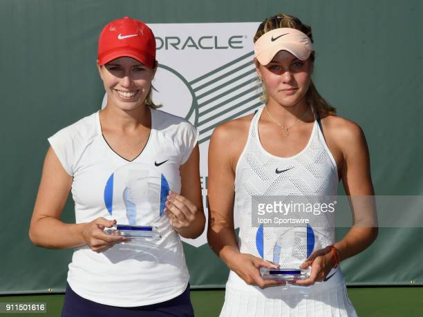Danielle Collins holds the women's championship trophy and Sofya Zhuk holds the runner up trophy after a three set finals match played at the Oracle...