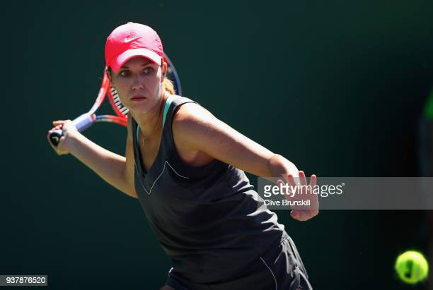 Danielle Collins of the United States plays a forehand against Donna Vekic of Croatia in their third round match during the Miami Open Presented by...