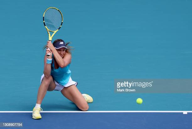 Danielle Collins of the United States returns a backhand during her women's singles first round match against Kristina Mladenovic of France on day...