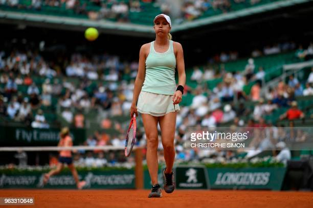 Danielle Collins of the US reacts after a point against Denmark's Caroline Wozniacki during their women's singles first round match on day two of The...