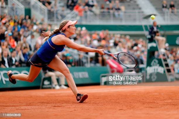 Danielle Collins of the US returns the ball to Australia's Ashleigh Barty during their women's singles second round match on day five of The Roland...