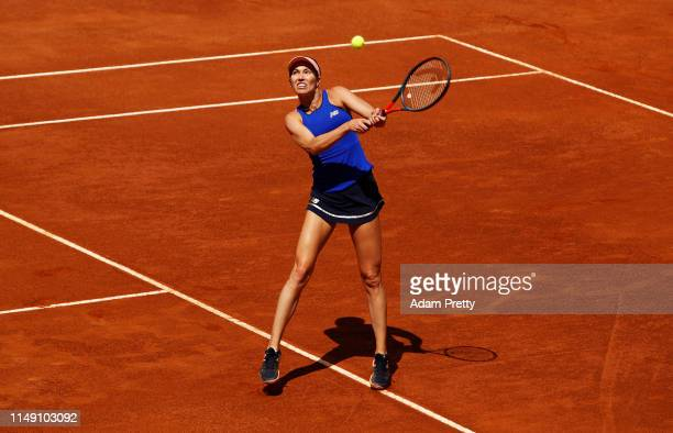 Danielle Collins of the USA hits a backhand during her first round match against Caroline Wozniacki of Denmark during day three of the International...