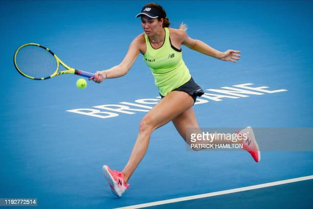 Danielle Collins of USA hits a return against Madison Keys of the US during their women's singles match at the Brisbane International tennis...