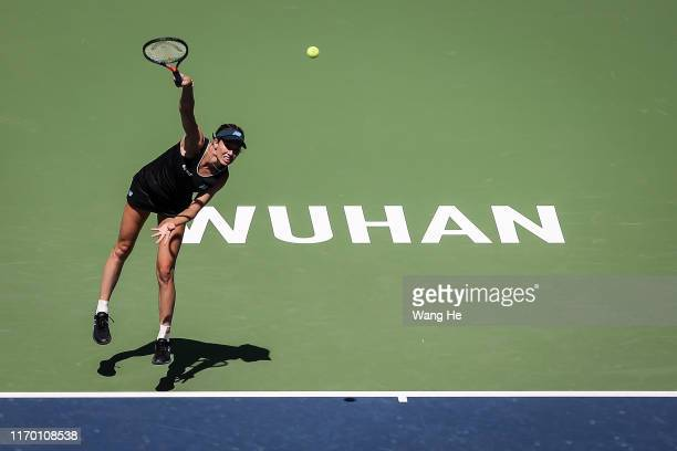 Danielle Collins of USA serves during the match against Venus Williams of USA on Day 1 of 2019 Dongfeng Motor Wuhan Open at Optics Valley...